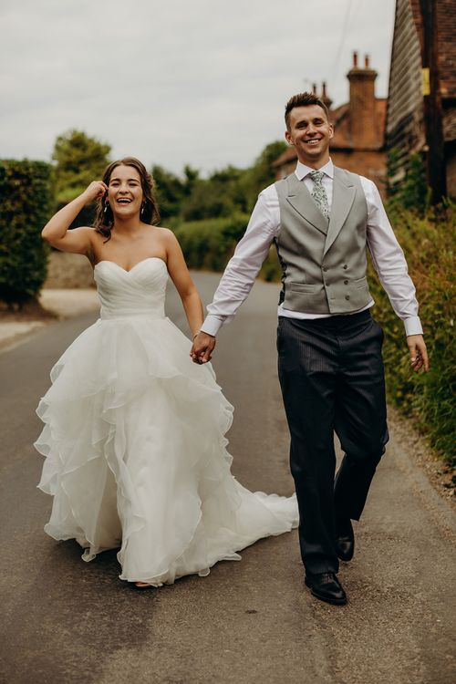 Bride wears strapless layered wedding dress