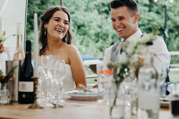 Bride and groom enjoy wedding speeches