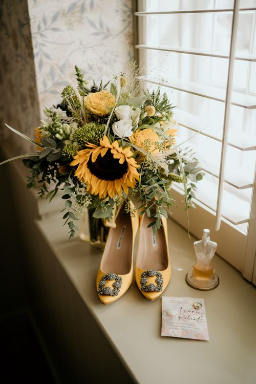 Yellow Manolo Blahnik Shoes and Sunflower Bouquet