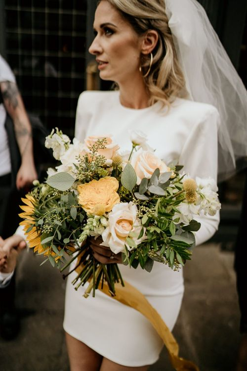 Yellow and green bridal bouquet with sunflower