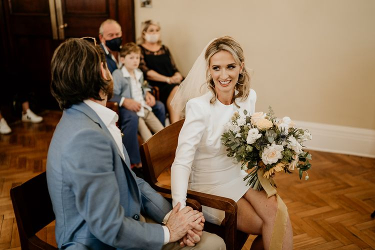 Stylish bride and groom at London city wedding