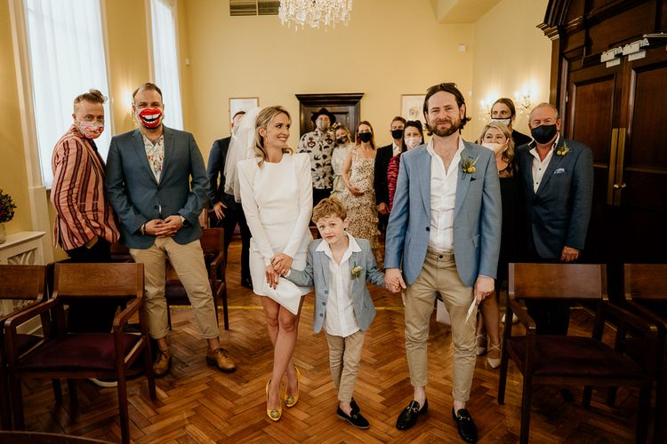 Bride and Groom with their son exiting the wedding ceremony