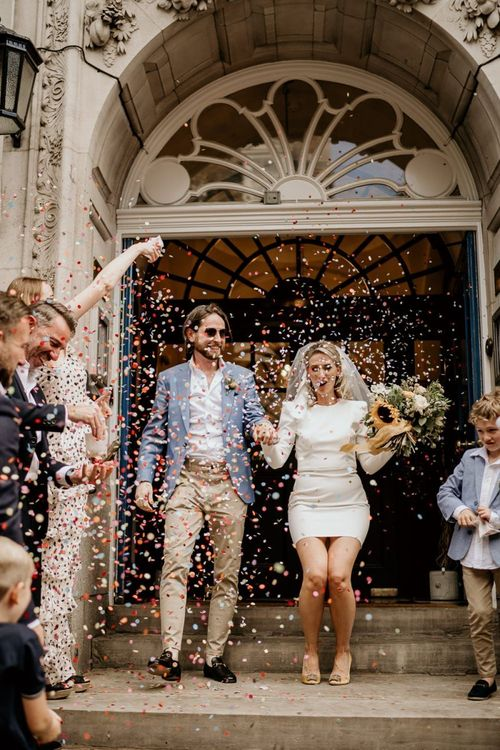 Confetti moment with bride in short wedding dress