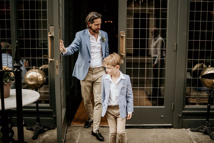 Groom and son in blue blazer and chinos