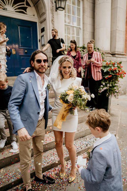 Stylish bride and groom at intimate London wedding