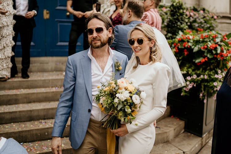 Stylish bride and groom in sunglasses at Intimate London wedding