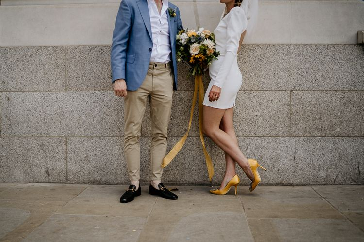 bride in short wedding dress with yellow shoes and groom in chinos and loafers