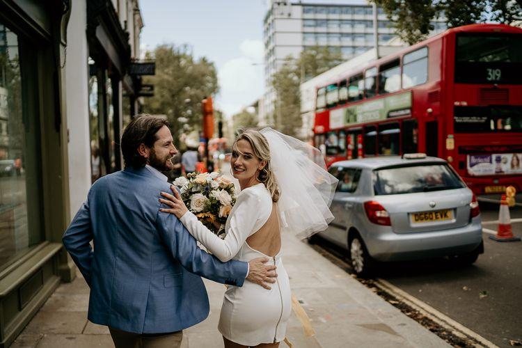 Bride in short wedding dress and veil