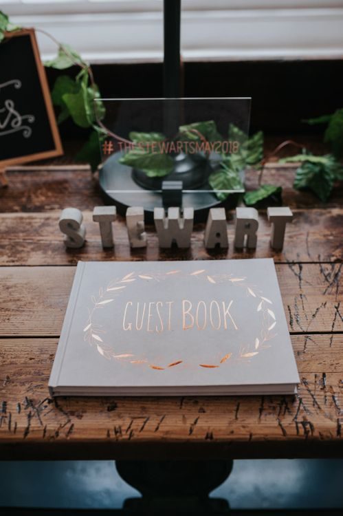 Copper Foil Wedding Guest Book | Pink Roll Top Booze Bath and Copper & Perspex Wedding Decor at Industrial Venue The West Mill | Rosie Kelly Photography