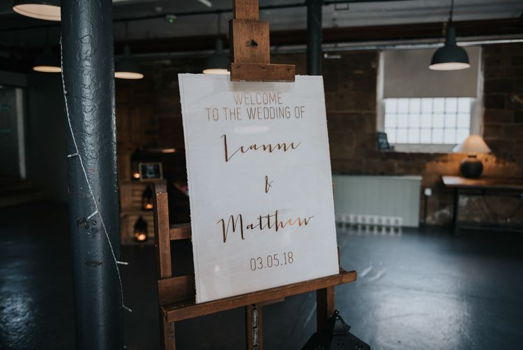 Acrylic Wedding Welcome Sign | Pink Roll Top Booze Bath and Copper & Perspex Wedding Decor at Industrial Venue The West Mill | Rosie Kelly Photography