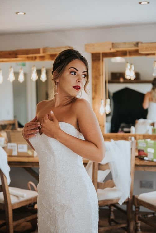 Beautiful Bride with Red Lipstick in Sweetheart Neckline Allure Wedding Dress | Pink Roll Top Booze Bath and Copper & Perspex Wedding Decor at Industrial Venue The West Mill | Rosie Kelly Photography