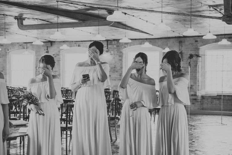 Bridesmaids in Off The Shoulder Green Sheln Dresses | Pink Roll Top Booze Bath and Copper & Perspex Wedding Decor at Industrial Venue The West Mill | Rosie Kelly Photography