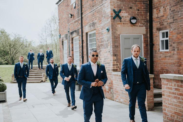 Groomsmen in Navy Ted Baker Suits from Moss Bros. | Pink Roll Top Booze Bath and Copper & Perspex Wedding Decor at Industrial Venue The West Mill | Rosie Kelly Photography