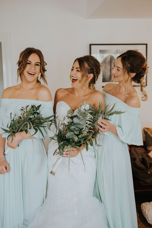 Bridal Party | Bride in Fishtail Allure Bridal Gown | Bridesmaids in Green off the Shoulder Sheln Dresses | Pink Roll Top Booze Bath and Copper & Perspex Wedding Decor at Industrial Venue The West Mill | Rosie Kelly Photography