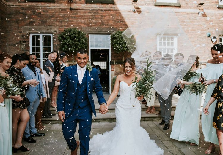 Confetti Exit | Bride in Fishtail Allure Bridal Gown | Groom in Navy Ted Baker Suit | Pink Roll Top Booze Bath and Copper & Perspex Wedding Decor at Industrial Venue The West Mill | Rosie Kelly Photography