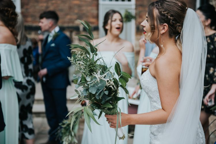 Greenery Wedding Bouquet | Bride in Fishtail Allure Bridal Gown | Pink Roll Top Booze Bath and Copper & Perspex Wedding Decor at Industrial Venue The West Mill | Rosie Kelly Photography
