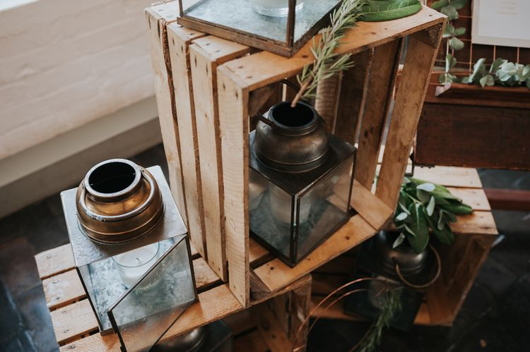 Lanterns in Wooden Crates Wedding Decor | Pink Roll Top Booze Bath and Copper & Perspex Wedding Decor at Industrial Venue The West Mill | Rosie Kelly Photography