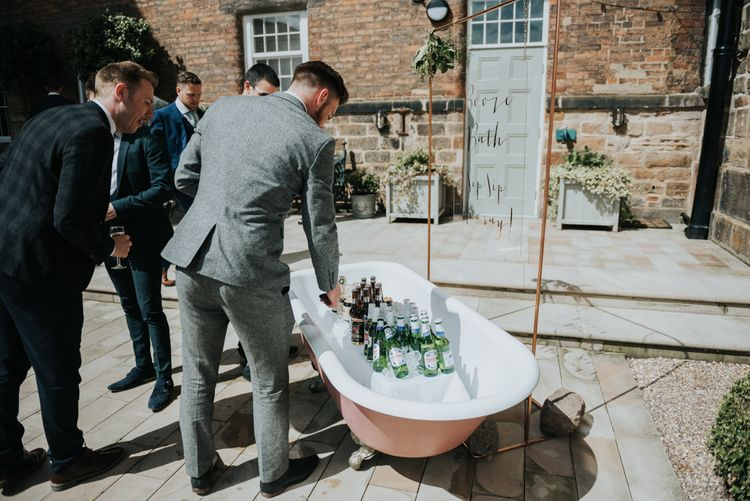 Pink Roll Top Booze Bath and Copper & Perspex Wedding Sign | Industrial Venue The West Mill | Rosie Kelly Photography