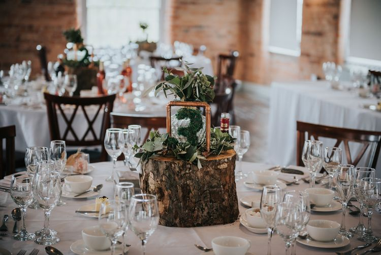Tree Stump, Moss Cover Table Number & Copper Frame Centrepiece | Pink Roll Top Booze Bath and Copper & Perspex Wedding Decor at Industrial Venue The West Mill | Rosie Kelly Photography
