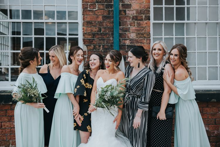 Best Girls | Bridesmaids in Mint Green Bardot Dresses from Sheln | Bride in Fishtail Allure Bridal Gown | Pink Roll Top Booze Bath and Copper & Perspex Wedding Decor at Industrial Venue The West Mill | Rosie Kelly Photography
