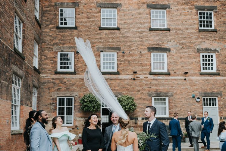 Bride in Fishtail Allure Bridal Gown | Pink Roll Top Booze Bath and Copper & Perspex Wedding Decor at Industrial Venue The West Mill | Rosie Kelly Photography