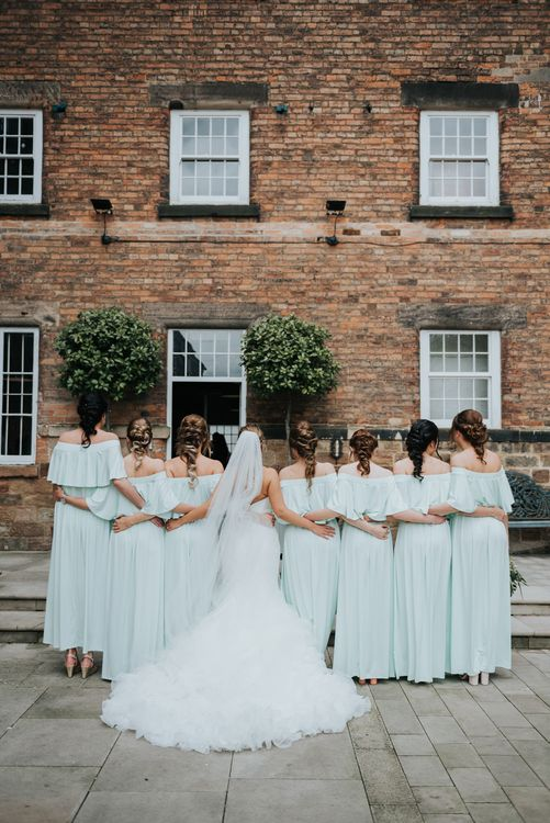 Bridal Party | Bridesmaids in Mint Green Bardot Dresses from Sheln | Bride in Fishtail Allure Bridal Gown | Pink Roll Top Booze Bath and Copper & Perspex Wedding Decor at Industrial Venue The West Mill | Rosie Kelly Photography