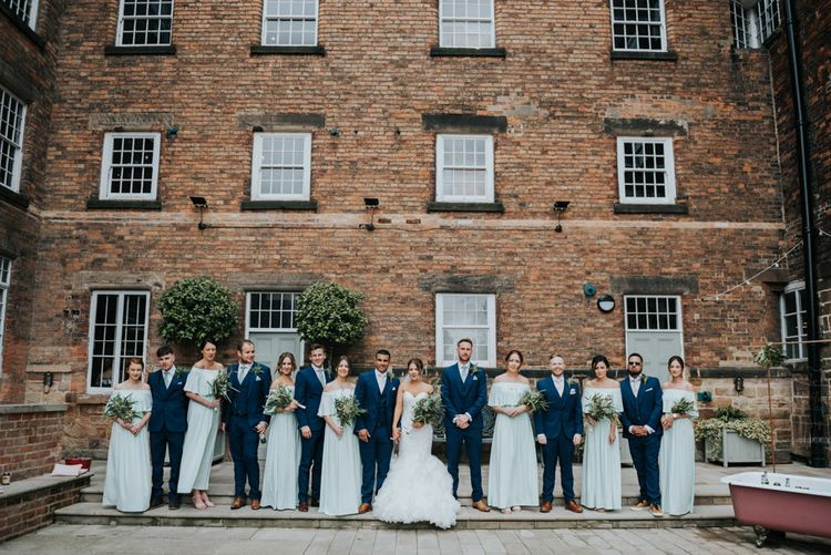 Wedding Party | Bridesmaids in Mint Green Bardot Dresses from Sheln | Bride in Fishtail Allure Bridal Gown | Groomsmen in Navy Ted Baker Suits | Pink Roll Top Booze Bath and Copper & Perspex Wedding Decor at Industrial Venue The West Mill | Rosie Kelly Photography