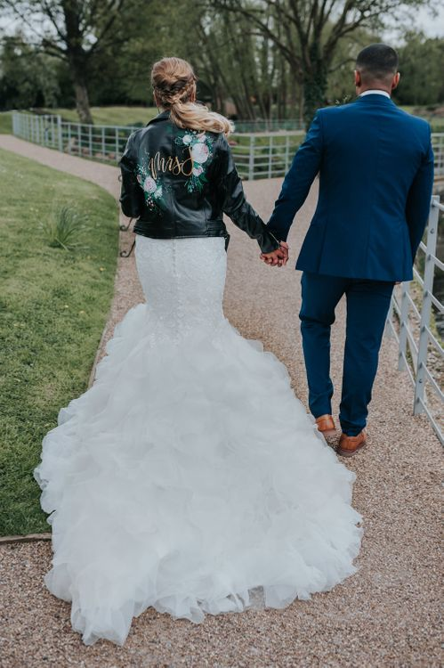 Customised Bridal Leather Jacket | Fishtail Allure Bridal Gown | Groom in Navy Ted Baker Suit | Pink Roll Top Booze Bath and Copper & Perspex Wedding Decor at Industrial Venue The West Mill | Rosie Kelly Photography