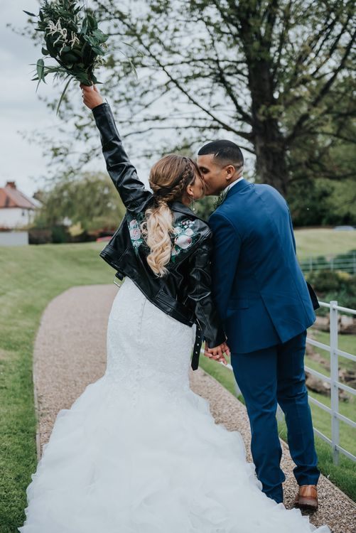 Customised Bridal Leather Jacket | Bridal Cover up | Fishtail Allure Bridal Gown | Groom in Navy Ted Baker Suit | Pink Roll Top Booze Bath and Copper & Perspex Wedding Decor at Industrial Venue The West Mill | Rosie Kelly Photography