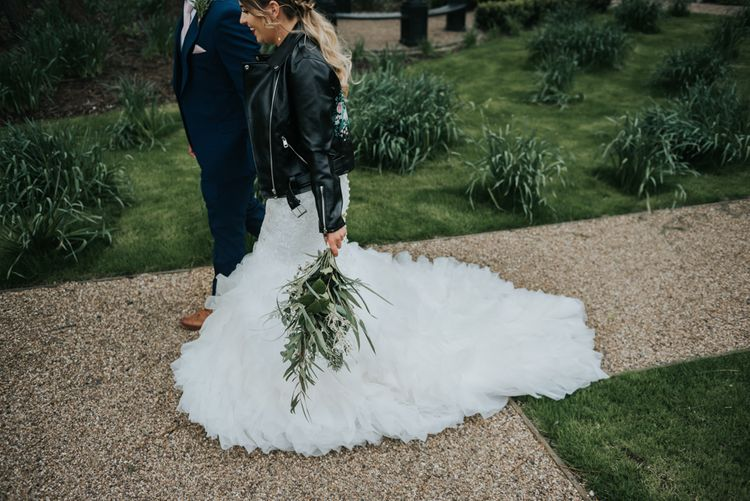 Greenery Bridal Bouquet | Customised Bridal Leather Jacket | Bridal Cover up | Fishtail Allure Bridal Gown | Groom in Navy Ted Baker Suit | Pink Roll Top Booze Bath and Copper & Perspex Wedding Decor at Industrial Venue The West Mill | Rosie Kelly Photography