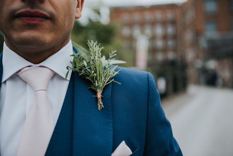 Greenery Buttonhole | Groom in Navy Ted Baker Suit | Pink Roll Top Booze Bath and Copper & Perspex Wedding Decor at Industrial Venue The West Mill | Rosie Kelly Photography