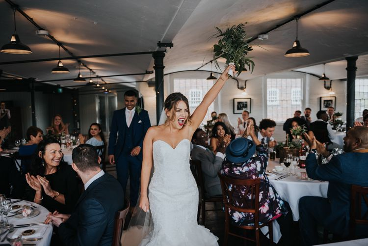 Bride in Fishtail Allure Bridal Gown | Groom in Navy Ted Baker Suit | Pink Roll Top Booze Bath and Copper & Perspex Wedding Decor at Industrial Venue The West Mill | Rosie Kelly Photography