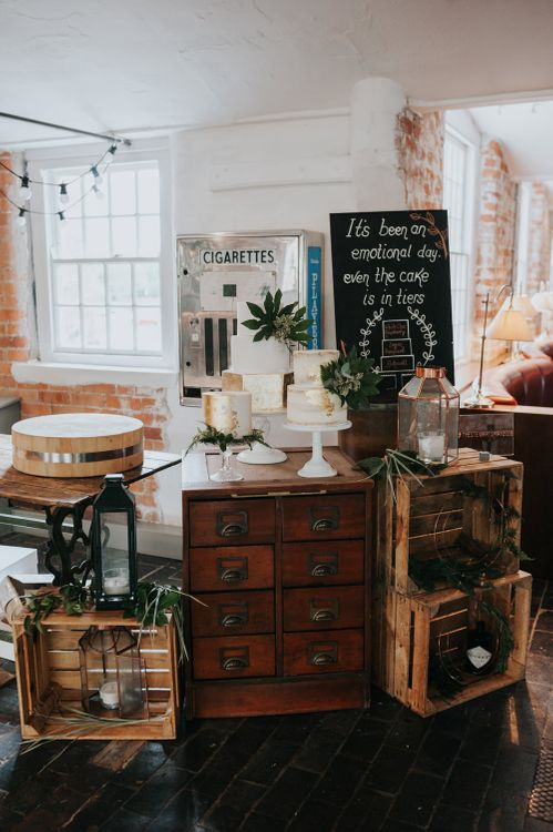 Wedding Cake Display | Gold Foil & White Wedding Cakes | Chalkboard Wedding Sign | Wooden Crates | Pink Roll Top Booze Bath and Copper & Perspex Wedding Decor at Industrial Venue The West Mill | Rosie Kelly Photography