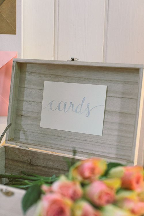 Wedding card box created out of a simple pale wooden box and the word 'Cards' brush lettered onto it in silver pen