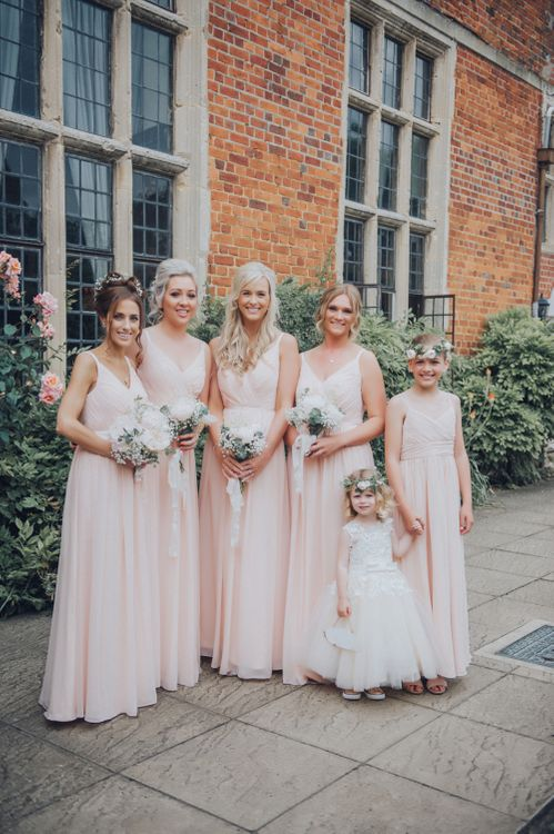Pastel Pink Bridesmaids Dresses // Pink Ruffled Chair Covers For Romantic Pastel Pink Wedding At Dorton House With Bride In La Sposa And Images From Julia & You Photography