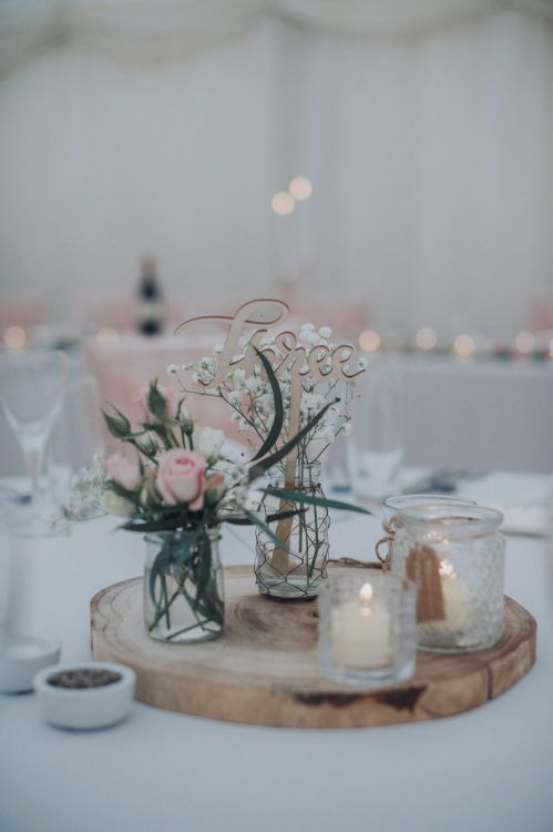 Log Slice Centre Pieces For Wedding // Pink Ruffled Chair Covers For Romantic Pastel Pink Wedding At Dorton House With Bride In La Sposa And Images From Julia & You Photography