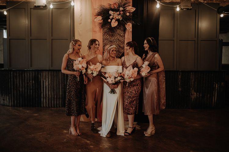 Bridal party portrait with bridesmaids in leopard print dresses
