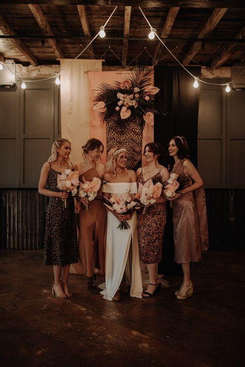 Stylish bridal party portrait with leopard print bridesmaid dresses