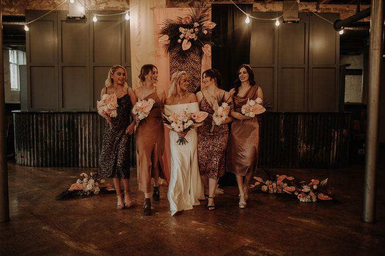 Silk leopard print bridesmaid dresses and complementing tones
