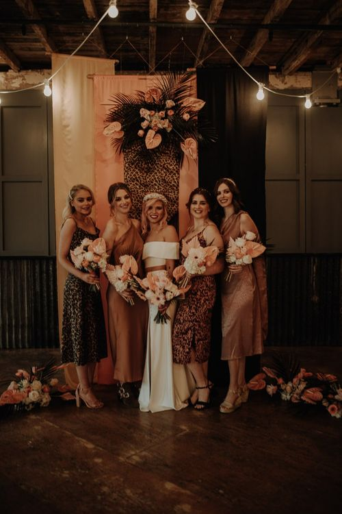 Stylish bridal party in leopard print bridesmaid dresses