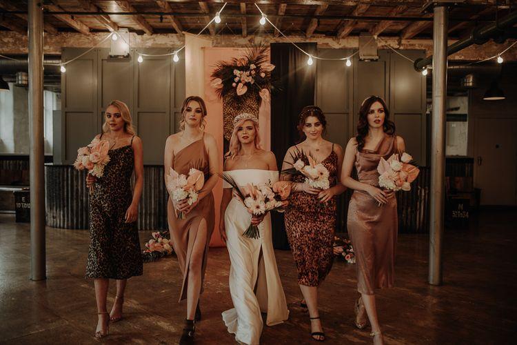 Bridesmaids in silk wedding dresses including leopard print dresses