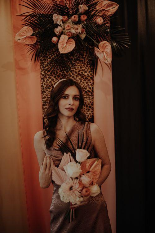 Leopard Print Bridesmaid Dresses with Tropical Bouquet