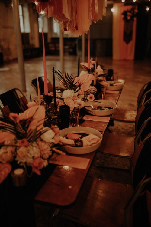 Intimate table scape with tropical flowers and candles