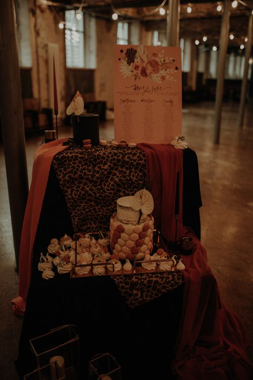 Dessert station and seating chart with leopard print cloth