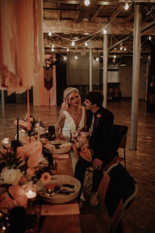Stylish bride and groom at industrial wedding
