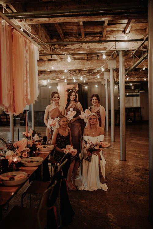 Industrial wedding with leopard print bridesmaid dresses