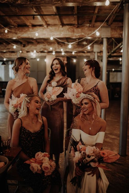 bridal party laughing in leopard print bridesmaid dresses