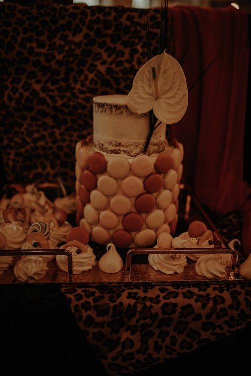 Wedding cake with macaroon decor and anthurium flower
