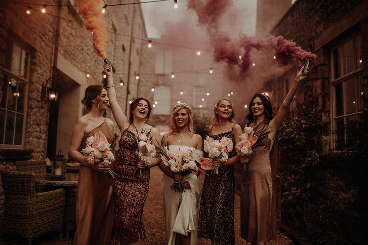 Bridal party smoke bomb portrait with leopard print bridesmaid dresses