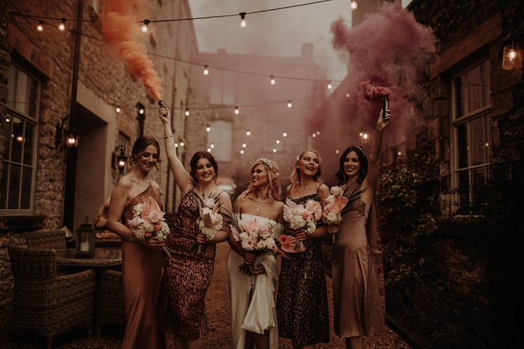 Wedding inspiration at Holmes Mill with festoon lights, smoke bombs and leopard print bridesmaid dresses